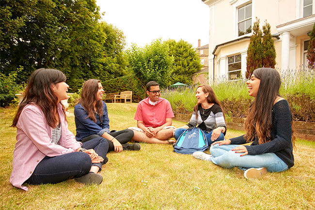 Students sitting in the garden